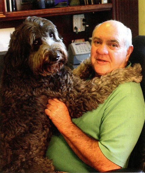 """Al Gordy with """"Smooch"""" - his certified therapy dog."""